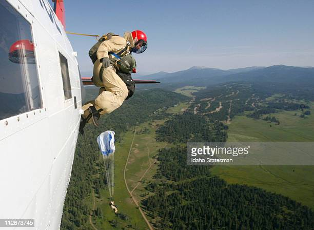 Smokejumper Larry Wilson exits a DC3TP airplane during training jumps near McCall Idaho while preparing for the 2008 fire season