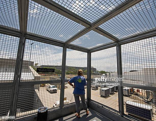 A smoker at Tampa International Airport takes a break at the airport's smoking area May 23 in Tampa Florida AFP Photo/Paul J Richards