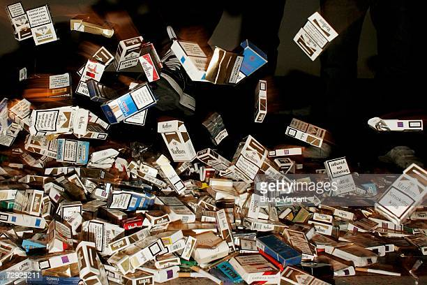 A smoker kicks a pile of smoking material at a photocall to mark the launch of Alan Carr's The easy way to stop smoking DVD on January 4 2007 in...