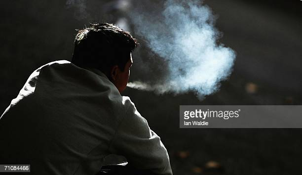 A smoker smokes a cigarette in the street May 30 2006 in Sydney Australia Today marks World No Tobacco Day which is sponsored by the World Health...