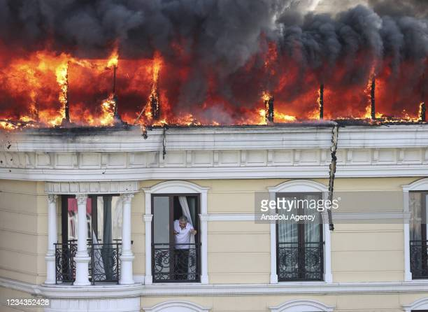 Smokes and flames rise after a fire breaks out on the roof of a hotel in Maltepe district of Turkish capital Ankara on July 31, 2021.