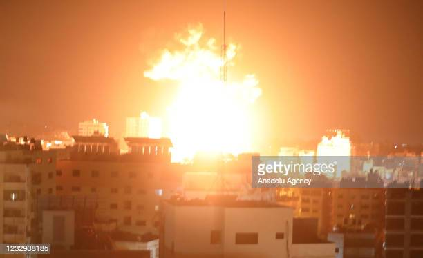 Smokes and flames rise after airstrikes by Israeli army hit buildings in Gaza City, Gaza on May 17, 2021.