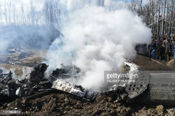 Smokes billows from the remains of an Indian Air Force helicopter after it crashed in Budgam district on the outskirts of Srinagar on February 27...