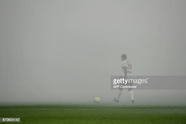 Smokes fills the air interrupting the match after smoke bombs were lobbed during the L1 football match AS SaintEtienne vs Olympique Lyonnais on...