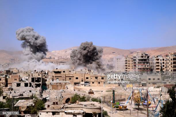 Smokes rise after Assad Regime forces carried out airstrikes in Eastern Ghouta's Douma town in Damascus Syria on April 07 2018 At least 47 civilians...