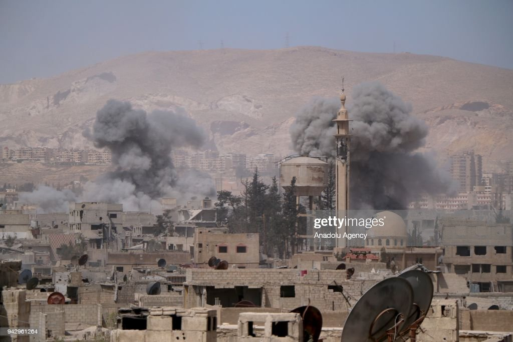 Smokes rise after Assad Regime forces carried out airstrikes in Eastern Ghouta's Douma town in Damascus, Syria on April 07, 2018. At least 47 civilians were killed by the Assad regime and its supporters in the airstrikes.