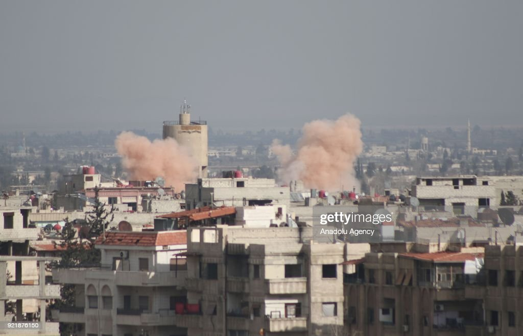 Smokes rise after Assad Regime forces carrired out airstrikes over Arbin town of the Eastern Ghouta region, which is a de-escalation zone of Damascus in Syria on February 20, 2018.