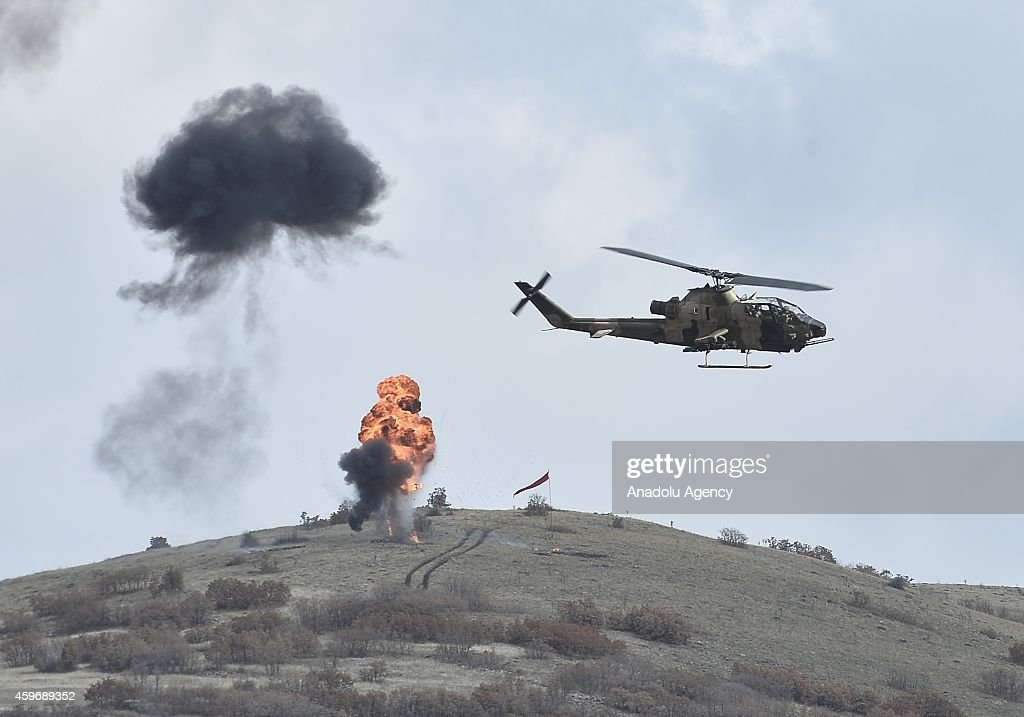 Smokes rise following helicopters bomb the ground during the joint 'Special Forces and Search and Rescue Military Drill' of the Turkish, Pakistani and Afghani Armies at Golbasi Facilities of Turkish Special Forces Command in Ankara, Turkey on November 28, 2014.
