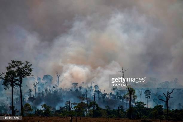 TOPSHOT Smokes rises from forest fires in Altamira Para state Brazil in the Amazon basin on August 27 2019 Brazil will accept foreign aid to help...