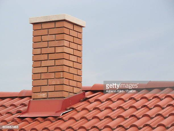 Smokes Stack On House Roof