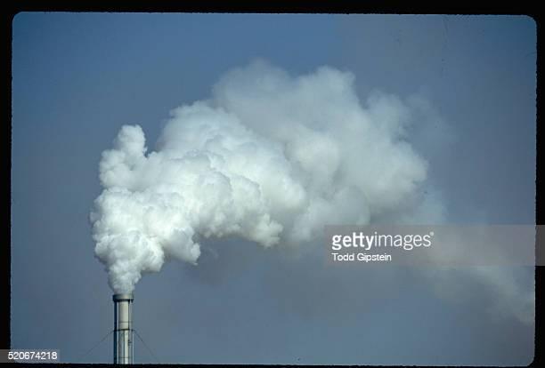 smokestack expelling smoke - gipstein stock pictures, royalty-free photos & images