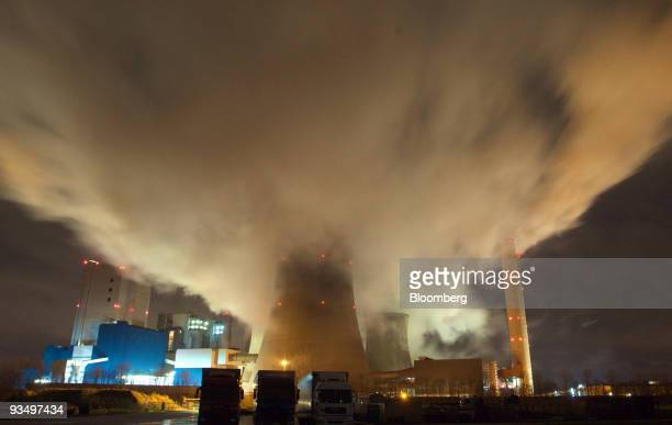 Smokestacks and cooling towers emit smoke and water vapor at the RWE AG owned coal-fired Niederaussem power station near Bergheim, Germany, on...