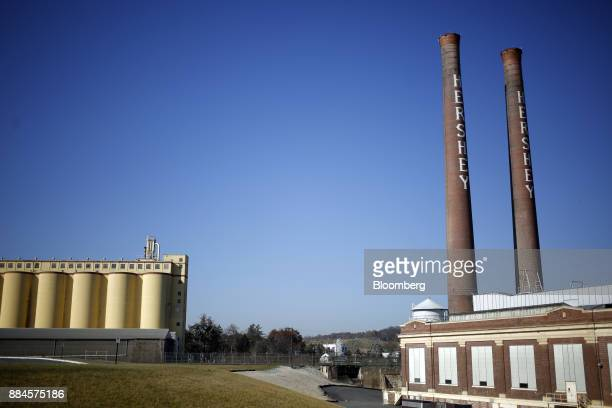 Smokestacks stand above the former Hershey Co manufacturing facility in Hershey Pennsylvania US on Tuesday Nov 28 2017 Hershey launched its first new...
