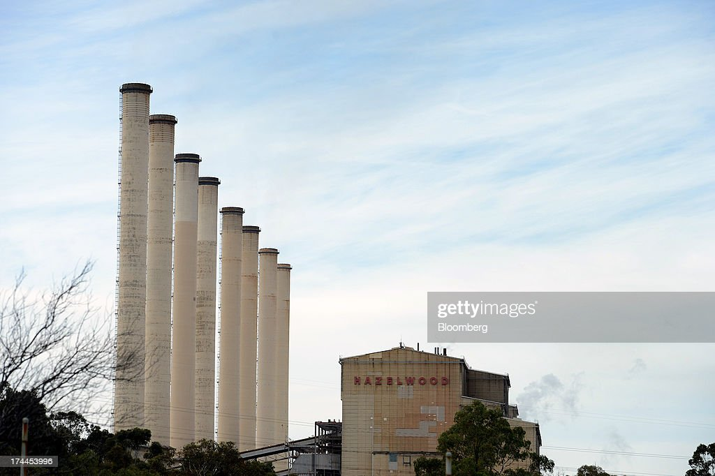 Smokestacks stand next to the main processing building of GDF Suez Australian Energy's Hazelwood coal-fired power station in Morwell, Australia, on Thursday, July 25, 2013. Australian Prime Minister Kevin Rudd will cut spending and limit tax concessions to fund a move to emissions trading a year ahead of schedule, should his Labor government win this year's election. Photographer: Carla Gottgens/Bloomberg via Getty Images