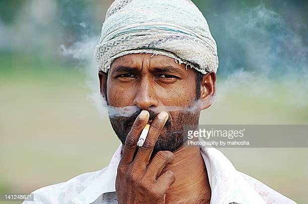 smokey moustache - bangladesh stock-fotos und bilder