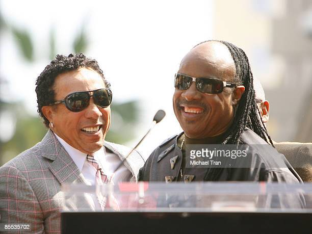 Smokey Robinson and Stevie Wonder attend the ceremony honoring The Miracles with a star on the Hollywood Walk of Fame on March 20 2009 in Hollywood...