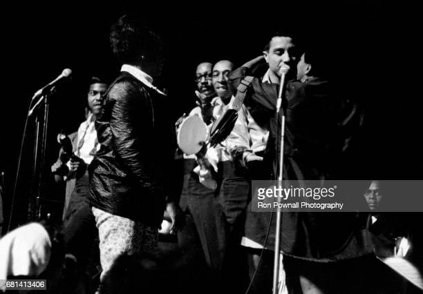 Smokey Robinson and the Miracles perform as a couple of fans run onstage at Evanston High School in Evanston Illinois September 1968
