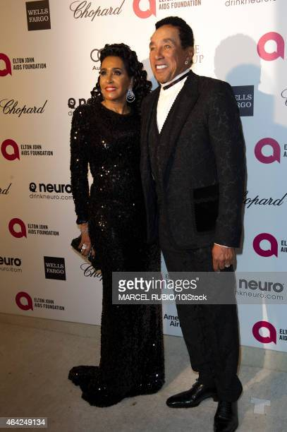 Smokey Robinson and wife Frances Gladney arrive for the 23rd Annual Elton John AIDS Foundation's Oscar Viewing Party February 22, 2015 in West...