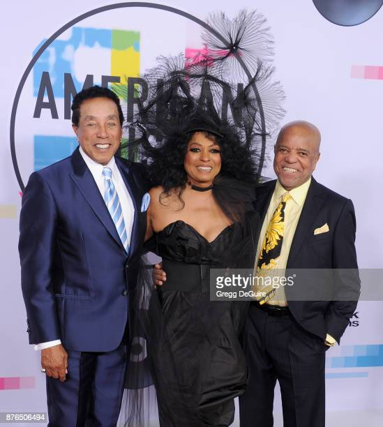 Smokey Robinson Diana Ross and Berry Gordy arrive at the 2017 American Music Awards at Microsoft Theater on November 19 2017 in Los Angeles California