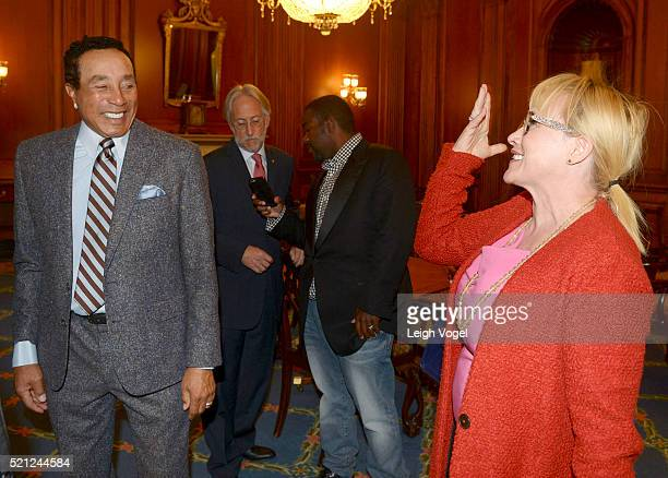 Smokey Robinson greets Patricia Arquette during GRAMMYs on the Hill Advocacy Day on Capitol Hill on April 14 2016 in Washington DC GRAMMY members...