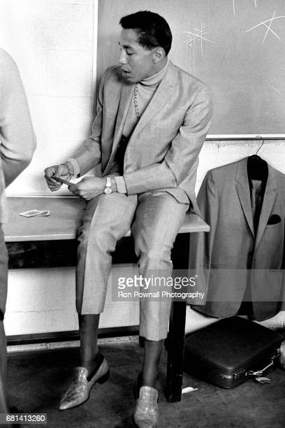 Smokey Robinson playing cards in boys locker room before going onstage at Evanston High School in Evanston Illinois September 1968