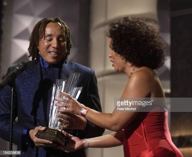 Smokey Robinson recieves award from BET COO Debra Lee