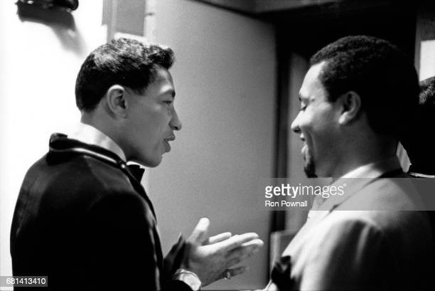 Smokey Robinson talking with one of The Miracles in boys locker room before going onstage at Evanston High School in Evanston Illinois September 1968