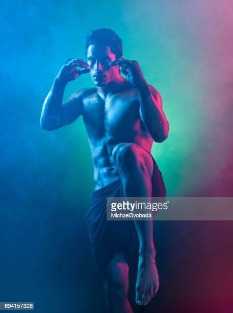 smokey surreal light on a mixed martial arts fighter - mixed martial arts stock pictures, royalty-free photos & images