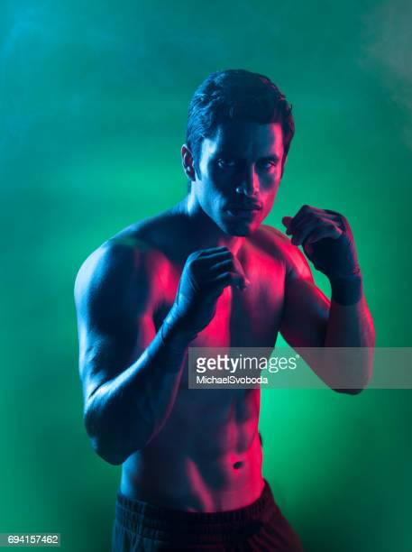 smokey surreal light on a mixed martial arts fighter - mma stock pictures, royalty-free photos & images