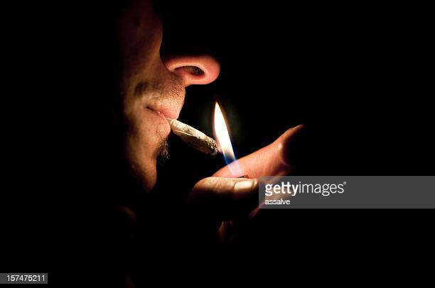 smoking a joint - smoking weed stock photos and pictures