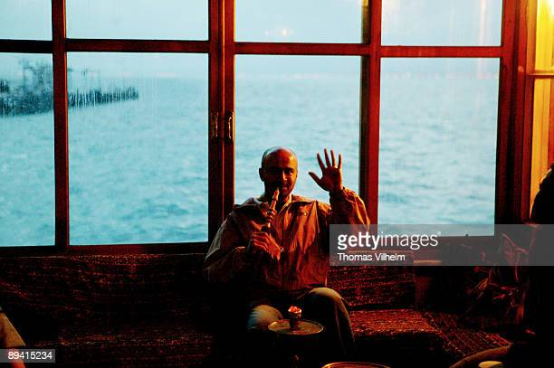 Smoking a water pipe in the Sea of Marmara IstanbulTurkey