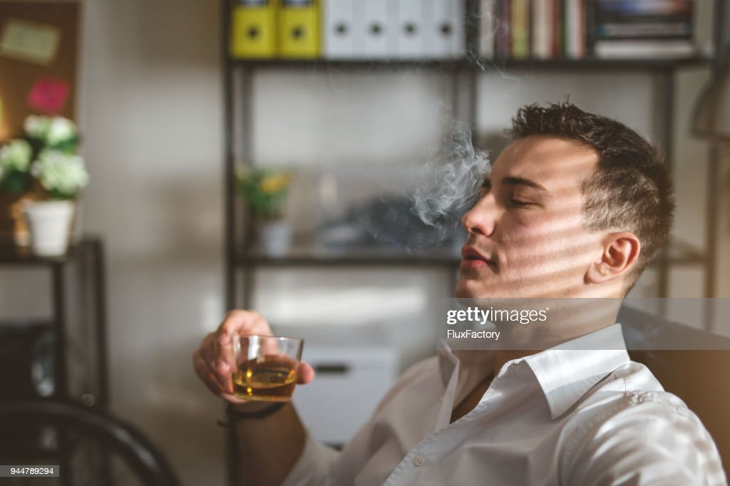 Smoking and drinking in the office : Stock Photo