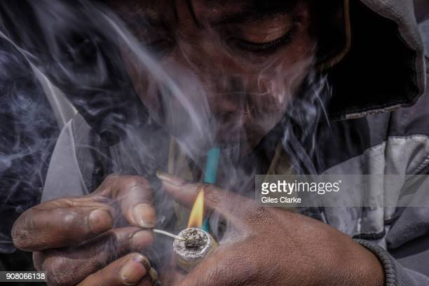 BOGOTA COLOMBIA JULY Smoking 'Bazuko' on the streets of Bogota Bogota has traditionally enjoyed lower homicide rates than other major cities in...