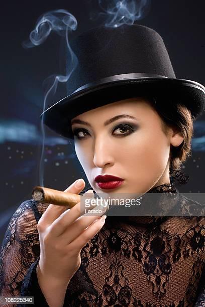 smoking beauty - beautiful women smoking cigars stock photos and pictures