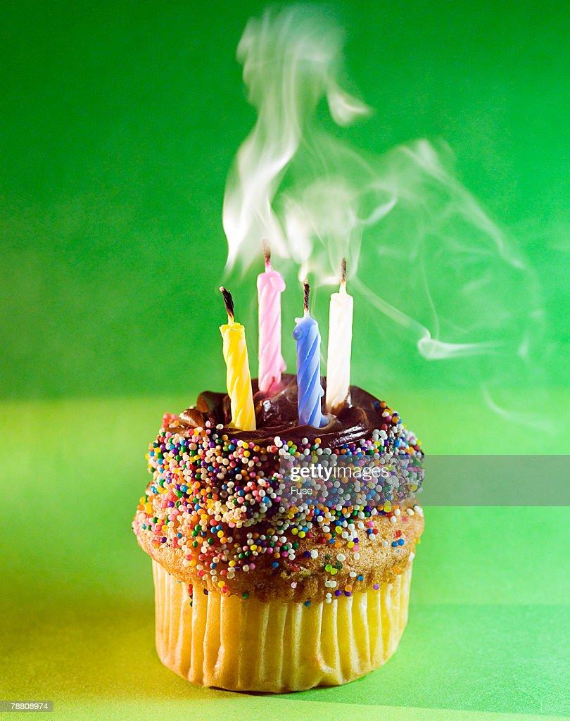 Smoking Birthday Candles On Cup Cake Stock Photo