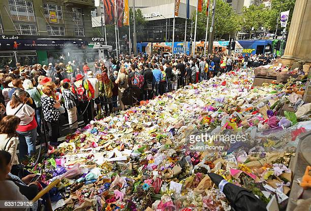 A smoking ceremony is held before the floral memorial on Bourke Street is removed on January 31 2017 in Melbourne Australia Six people have now died...