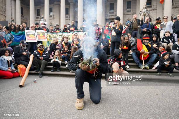 A smoking ceremony is held on the steps of Parliament house on July 6 2018 in Melbourne Australia The march marks the start of NAIDOC Week which runs...