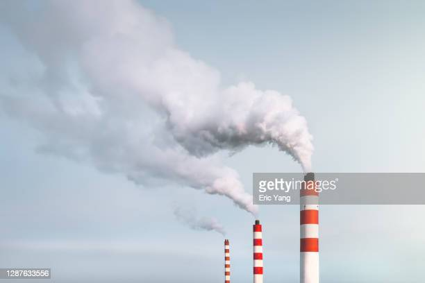 smoking chimneys - factory stock pictures, royalty-free photos & images