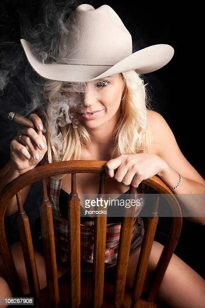 smoking cowgirl portrait - beautiful women smoking cigars stock photos and pictures