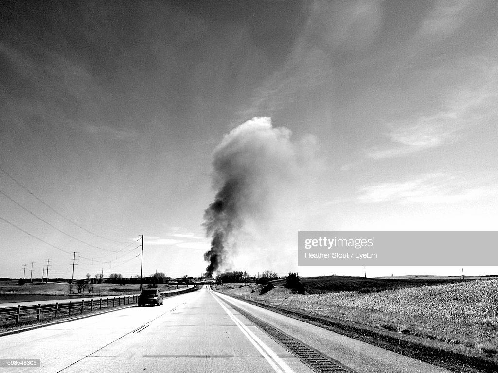 Smoking Emitting From Road Against Sky : Stock Photo