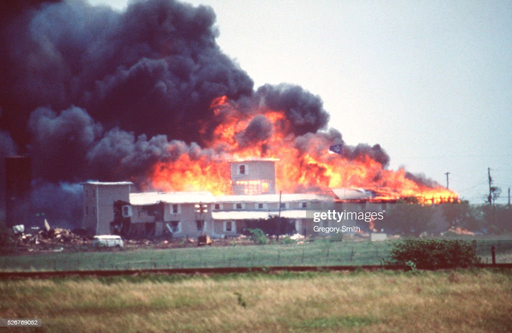 Smoking fire consumes the Branch Davidian Compound during the FBI assault to end the 51-day standoff with cult leader David Koresh and his followers. --- Photo by Greg Smith/Corbis SABA
