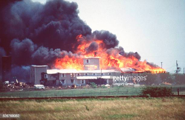 Smoking fire consumes the Branch Davidian Compound during the FBI assault to end the 51-day standoff with cult leader David Koresh and his followers....