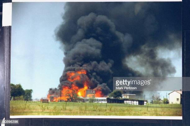 Smoking fire consuming David Koreshled Branch Davidian cult compound it remains unclear if the fire was started on the orders of Koresh or when tanks...