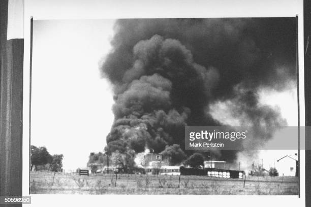 Smoking fire consuming David Koresh-led Branch Davidian cult compound; it remains unclear if the fire was started on the orders of Koresh or when...