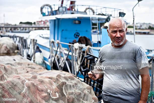 smoking fisherman on quay - quayside stock pictures, royalty-free photos & images