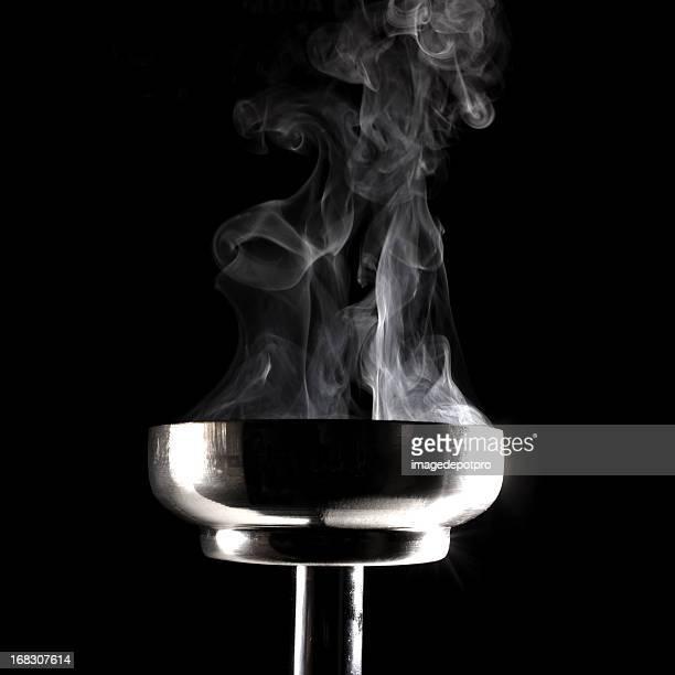 smoking flaming torch