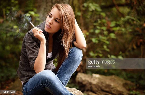 smoking girl - beautiful women smoking cigarettes stock photos and pictures
