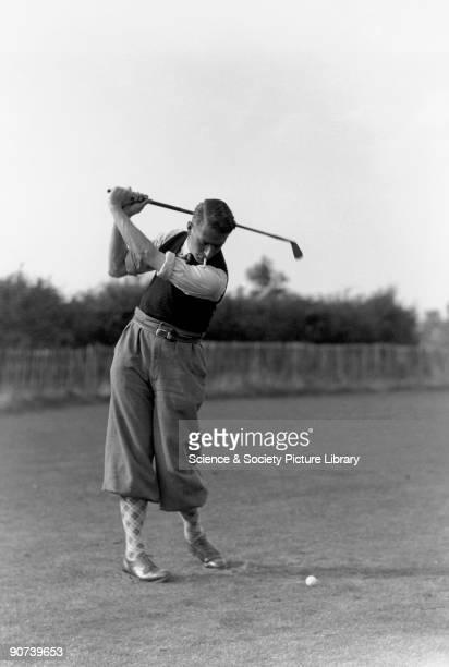 Smoking golfer caught in midswing c 1930s