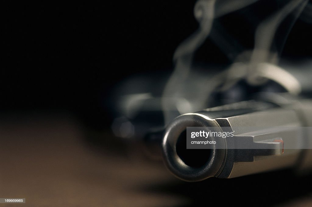 Smoking gun lying on the floor, revolver : Stock Photo