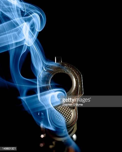 smoking gun - gun barrel stock pictures, royalty-free photos & images